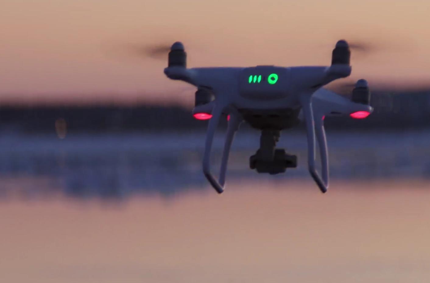 the dji phantom 4 drone capturing a sunset